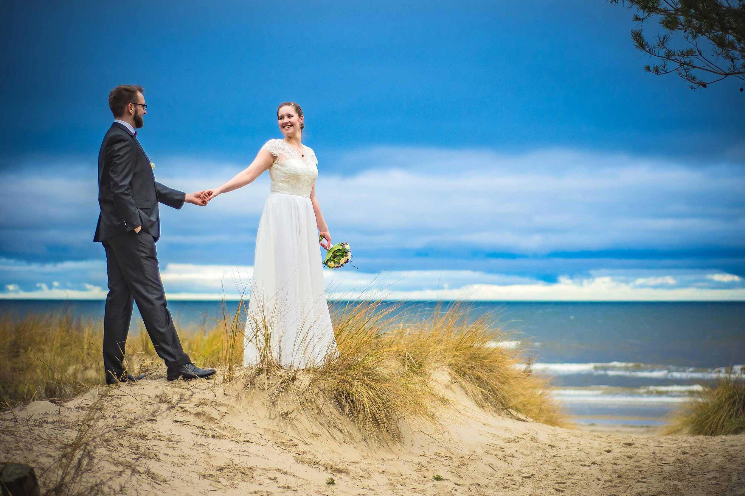 Hochzeitsfoto Strand lächeln Strandzugang
